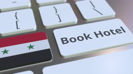 гостеприимство : BOOK HOTEL text and flag of Syria on the buttons on the computer keyboard. Travel related conceptual 3D animation