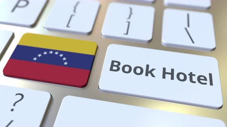 гостеприимство : BOOK HOTEL text and flag of Venezuela on the buttons on the computer keyboard. Travel related conceptual 3D animation
