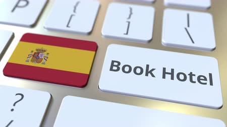 гостеприимство : BOOK HOTEL text and flag of Spain on the buttons on the computer keyboard. Travel related conceptual 3D animation