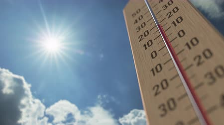 reaching : Outdoor thermometer reaches 35 thirty-five degrees centigrade. Weather forecast related 3D animation Stock Footage