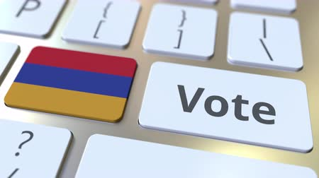 poll : VOTE text and flag of Armenia on the buttons on the computer keyboard. Election related conceptual 3D animation