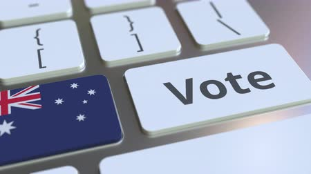 candidato : VOTE text and flag of Australia on the buttons on the computer keyboard. Election related conceptual 3D animation Vídeos