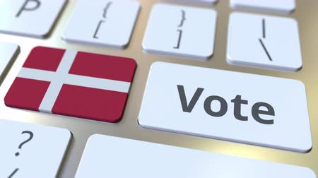 no exterior : VOTE text and flag of Denmark on the buttons on the computer keyboard. Election related conceptual 3D animation