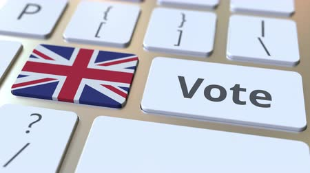 democrático : VOTE text and flag of Great Britain on the buttons on the computer keyboard. Election related conceptual 3D animation