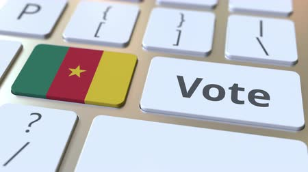 democrático : VOTE text and flag of Cameroon on the buttons on the computer keyboard. Election related conceptual 3D animation