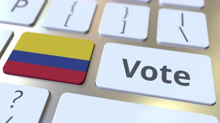democrático : VOTE text and flag of Colombia on the buttons on the computer keyboard. Election related conceptual 3D animation