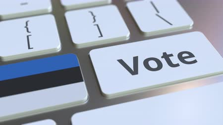 poll : VOTE text and flag of Estonia on the buttons on the computer keyboard. Election related conceptual 3D animation Stock Footage