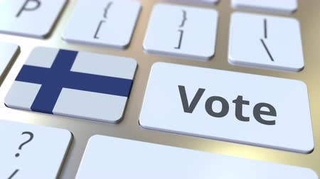 demokratický : VOTE text and flag of Finland on the buttons on the computer keyboard. Election related conceptual 3D animation