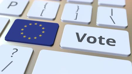 candidato : VOTE text and flag of the European Union on the buttons on the computer keyboard. Election related conceptual 3D animation