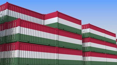 венгерский : Container terminal full of containers with flag of Hungary. Hungarian export or import related loopable 3D animation