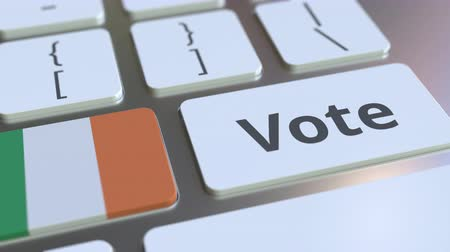 poll : VOTE text and flag of the Republic of Ireland on the buttons on the computer keyboard. Election related conceptual 3D animation Stock Footage
