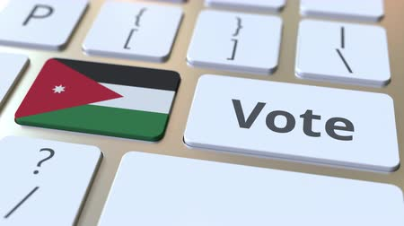 kandidát : VOTE text and flag of Jordan on the buttons on the computer keyboard. Election related conceptual 3D animation Dostupné videozáznamy