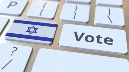 candidato : VOTE text and flag of Israel on the buttons on the computer keyboard. Election related conceptual 3D animation
