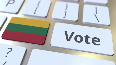 candidato : VOTE text and flag of Lithuania on the buttons on the computer keyboard. Election related conceptual 3D animation Vídeos