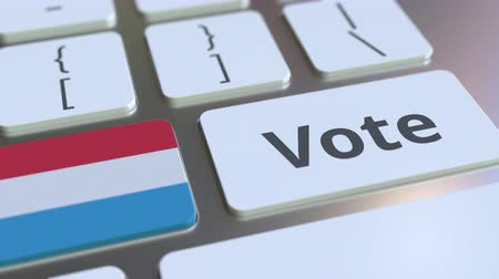 poll : VOTE text and flag of Luxembourg on the buttons on the computer keyboard. Election related conceptual 3D animation