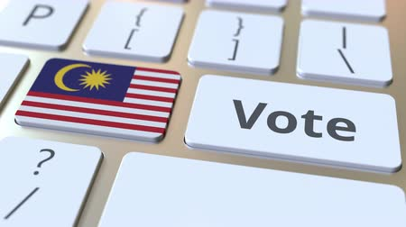 demokratický : VOTE text and flag of Malaysia on the buttons on the computer keyboard. Election related conceptual 3D animation