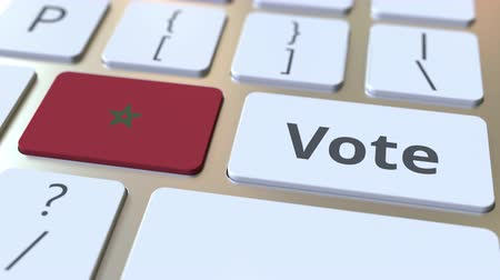 demokratický : VOTE text and flag of Morocco on the buttons on the computer keyboard. Election related conceptual 3D animation