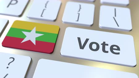 demokratický : VOTE text and flag of Myanmar on the buttons on the computer keyboard. Election related conceptual 3D animation