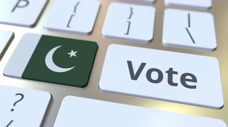 demokratický : VOTE text and flag of Pakistan on the buttons on the computer keyboard. Election related conceptual 3D animation