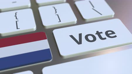 demokratický : VOTE text and flag of the Netherlands on the buttons on the computer keyboard. Election related conceptual 3D animation Dostupné videozáznamy