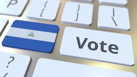 demokratický : VOTE text and flag of Nicaragua on the buttons on the computer keyboard. Election related conceptual 3D animation