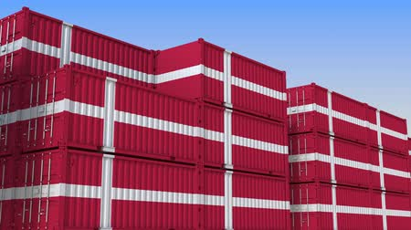 deense dog : Container yard full of containers with flag of Denmark. Danish export or import related loopable 3D animation