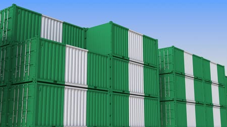 nigeria flag : Container yard full of containers with flag of Nigeria. Nigerian export or import related loopable 3D animation