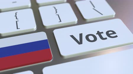 poll : VOTE text and flag of Russia on the buttons on the computer keyboard. Election related conceptual 3D animation Stock Footage