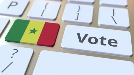 demokratický : VOTE text and flag of Senegal on the buttons on the computer keyboard. Election related conceptual 3D animation Dostupné videozáznamy