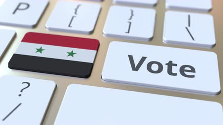 demokratický : VOTE text and flag of Syria on the buttons on the computer keyboard. Election related conceptual 3D animation