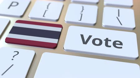 demokratický : VOTE text and flag of Thailand on the buttons on the computer keyboard. Election related conceptual 3D animation