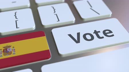 democrático : VOTE text and flag of Spain on the buttons on the computer keyboard. Election related conceptual 3D animation Stock Footage