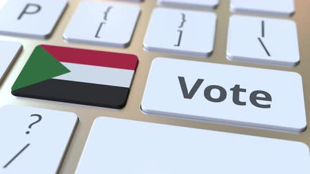 demokratický : VOTE text and flag of Sudan on the buttons on the computer keyboard. Election related conceptual 3D animation