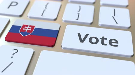 demokratický : VOTE text and flag of Slovakia on the buttons on the computer keyboard. Election related conceptual 3D animation