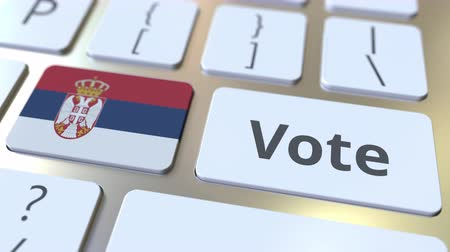demokratický : VOTE text and flag of Serbia on the buttons on the computer keyboard. Election related conceptual 3D animation Dostupné videozáznamy