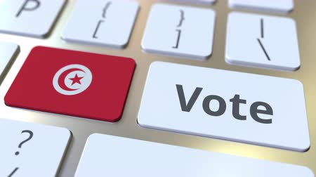 democrático : VOTE text and flag of Tunisia on the buttons on the computer keyboard. Election related conceptual 3D animation Stock Footage