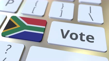 demokratický : VOTE text and flag of South Africa on the buttons on the computer keyboard. Election related conceptual 3D animation