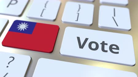 demokratický : VOTE text and flag of Taiwan on the buttons on the computer keyboard. Election related conceptual 3D animation