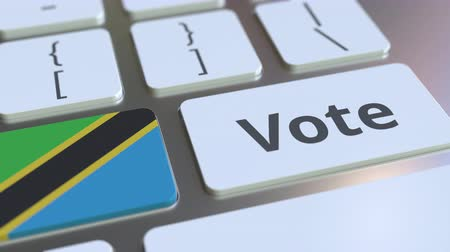 demokratický : VOTE text and flag of Tanzania on the buttons on the computer keyboard. Election related conceptual 3D animation