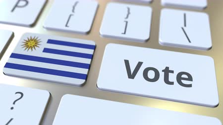 demokratický : VOTE text and flag of Uruguay on the buttons on the computer keyboard. Election related conceptual 3D animation