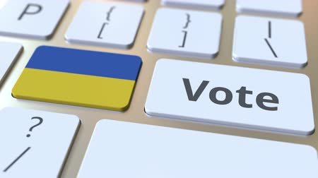 demokratický : VOTE text and flag of Ukraine on the buttons on the computer keyboard. Election related conceptual 3D animation