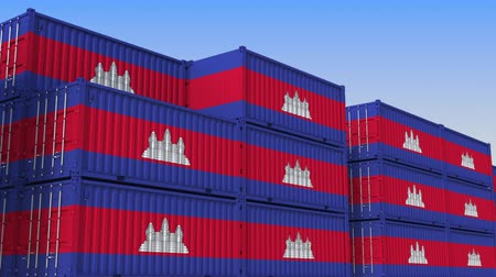 kamboçyalı : Container yard full of containers with flag of Cambodia. Cambodian export or import related loopable 3D animation