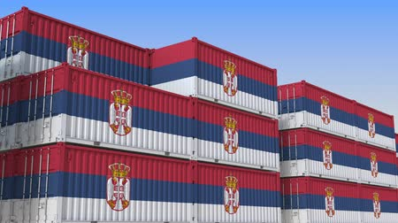 sérvia : Container yard full of containers with flag of Serbia. Serbian export or import related loopable 3D animation