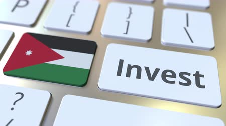 Иордания : INVEST text and flag of Jordan on the buttons on the computer keyboard. Business related conceptual 3D animation