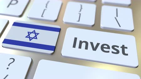 jood : INVEST text and flag of Israel on the buttons on the computer keyboard. Business related conceptual 3D animation