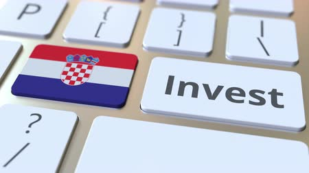 de ativos : INVEST text and flag of Croatia on the buttons on the computer keyboard. Business related conceptual 3D animation Stock Footage