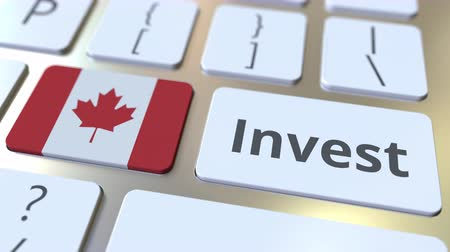 canadense : INVEST text and flag of Canada on the buttons on the computer keyboard. Business related conceptual 3D animation Stock Footage