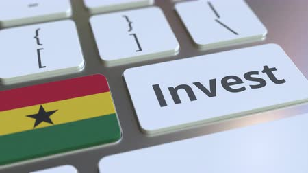 de ativos : INVEST text and flag of Ghana on the buttons on the computer keyboard. Business related conceptual 3D animation Stock Footage