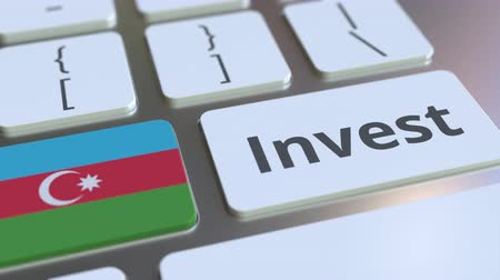 fondo industrial : INVEST text and flag of Azerbaijan on the buttons on the computer keyboard. Business related conceptual 3D animation