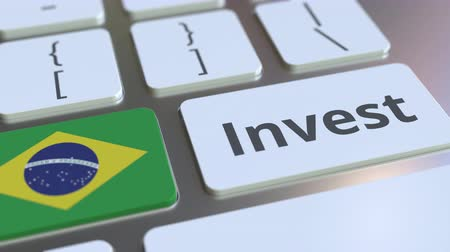 bens : INVEST text and flag of Brazil on the buttons on the computer keyboard. Business related conceptual 3D animation Stock Footage